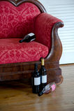 Wine bottles and sofa Stock Photo