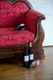 Wine bottles and sofa Stock Photo