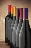 Wine bottles stacked in a row Royalty Free Stock Photo