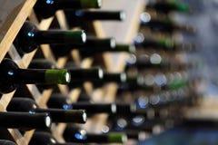Wine bottles stacked on wooden racks Stock Image