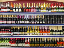 Wine bottles on store window Royalty Free Stock Images