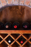Wine bottles stored in a shelves Stock Photography