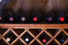 Wine bottles stored in a shelves Stock Photos