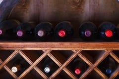 Wine bottles stored in a shelves. Wine bottles stored in the shelves Stock Photos
