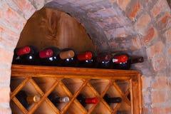 Wine bottles stored in the shelves. Wine bottles stored in the shelves Stock Image