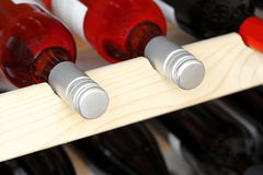 Wine bottles stored in a stack Royalty Free Stock Images