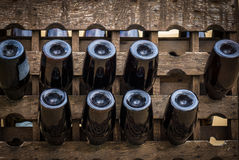 The wine bottles stored in a wood rack Royalty Free Stock Photos