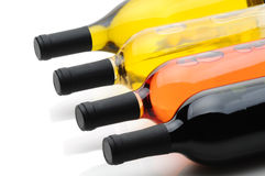Wine Bottles on their side. Closeup of four wine bottles laying on their side. Cabernet Sauvignon, White Zinfandel, Pinot Grigio, and Chardonnay bottles are Stock Image
