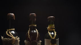Wine bottles tops in the dark stock footage