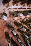 Wine bottles on wall Royalty Free Stock Image