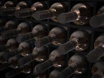 Wine bottles in wine cellar. Dusty wine bottles in old wine cellar Royalty Free Stock Image