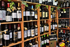 Wine bottles in the wine store, Portugal. Cascais, Portugal - June 13, 2017: Shelves with varieties sorts of bottles of wine and port wine in the wine store royalty free stock images