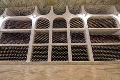 Wine bottle wall in winery. Wine bottles in winery cellars, old wine bottles storage in the underground royalty free stock photos