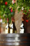 Wine bottles on wodden barrel Stock Photos