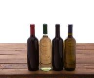 Wine bottles on wooden background Stock Image