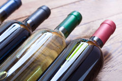 Wine bottles on wooden background Stock Photography