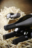 Wine bottles in wooden box and straw Stock Photography