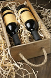 Wine bottles in wooden box and straw Stock Image