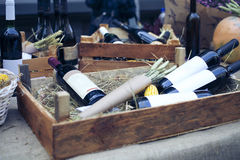 Wine bottles in wooden boxes Stock Photo