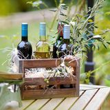 Wine bottles in a wooden crate Stock Photo