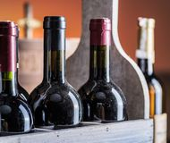 Wine bottles in wooden crate and oak wine keg. stock photo