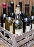 Wine bottles in a wooden crate . Old wine bottles in a wooden crate stock image