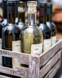 Wine bottles in a wooden crate . Stock Photography