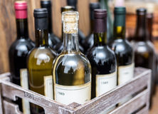 Wine bottles in a wooden crate . Stock Photos