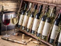 Wine bottles on the wooden shelf. Royalty Free Stock Photos