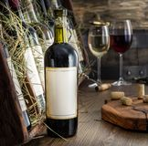 Wine bottles on the wooden shelf. Royalty Free Stock Photography