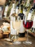 Wine bottles on the wooden shelf. Stock Photos