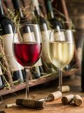 Wine bottles on the wooden shelf. Royalty Free Stock Images