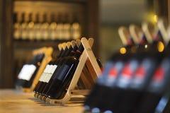 Wine bottles on a wooden shelf. Royalty Free Stock Photo