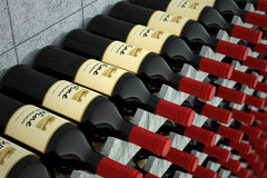 Wine bottles on a wooden shelf. Royalty Free Stock Images