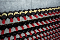 Wine bottles on a wooden shelf. Stock Image