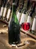 Wine bottles on the wooden shelf. Stock Photo