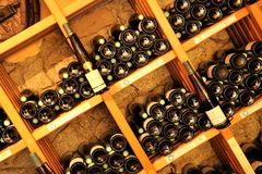 Wine bottles on wooden shelves Royalty Free Stock Photography