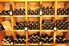Wine bottles on wooden shelves Stock Image