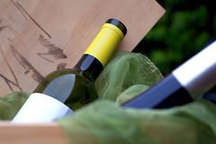 Wine-bottles in wooden winebox Royalty Free Stock Photography