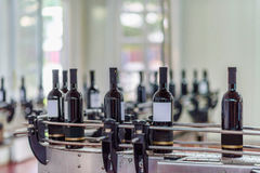 Wine bottling and sealing conveyor Stock Photos