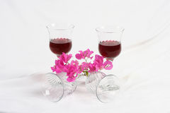 Wine and bougainvillea flowers. Wine in glasses with pink vines of bougainvillea flowers Stock Image