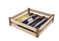Wine box full of bottles. Wine bottles in wooden box isolated on white in studio shooting Royalty Free Stock Photos