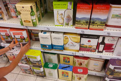 Wine boxes. BELGIUM - JULY 2015: Shelves with Cardboard wine cartons of 3 and 5 liter in a Carrefour Supermarket Royalty Free Stock Image