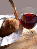Wine and Bread. Glass of red wine with loaf of bread in basket-nice combination of texture royalty free stock photography