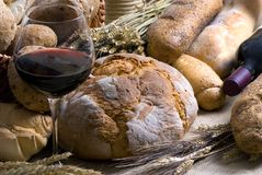 Wine and Bread 2 12-10. Red wine and an assortment of fresh breads Royalty Free Stock Photos