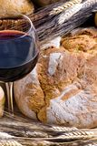 Wine and Bread 4. An inviting glass of red wine with an assortment of fresh breads Royalty Free Stock Photos