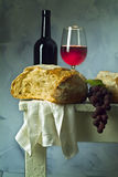 Wine and bread. Red wine glass, bottle and loaf of sour dough bread Royalty Free Stock Image