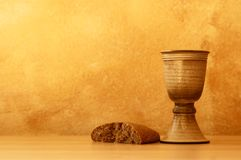 Wine and bread. Chalice with wine and bread. Background with copy space Stock Photos