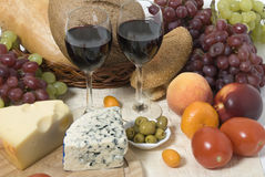Wine, bread. cheese, fruit and vegetables. Various fruit and vegetables grape olive orange, cheese, bread and wine glasses Royalty Free Stock Photography