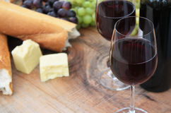 Wine, Bread, Cheese, Grapes on Outdoor Table Royalty Free Stock Image